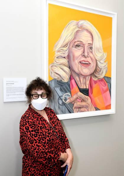 Artist Grace Graupe-Pillard stands next to her Edith Windsor portrait