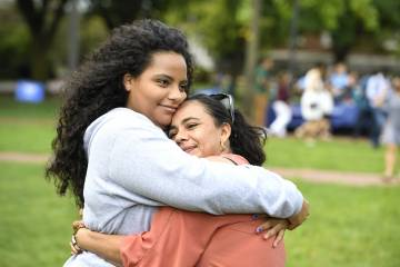 A student hugs her mother