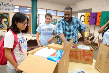 A group unpacks boxes of supplies