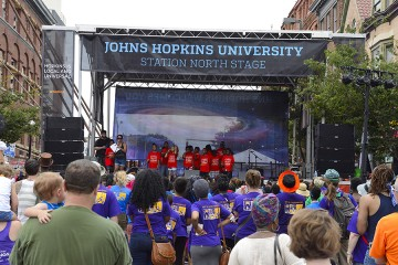 student perform on the Johns Hopkins University stage