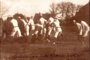 Old fashioned photo of men playing football