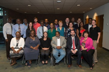 A group photo of the graduates and program leaders