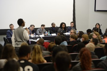 An alumnus addresses the panel of administrators and representatives of the Black Student Union