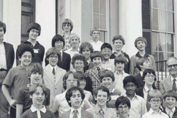 A black and white photo of a group of students on steps