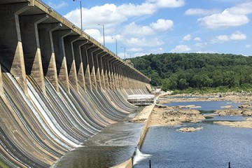 Spillway of the Conowingo Dam shows water filtering out from a large concrete structure