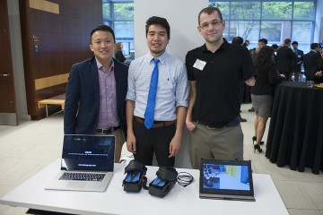 the three GEAR teammates pose with their design and two computers