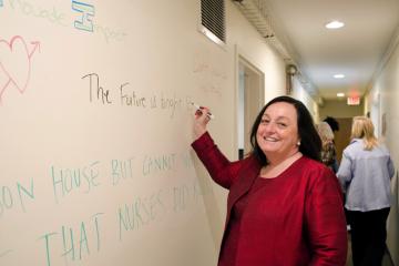 Patricia Davidson writes on the wall