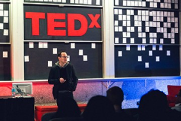 Speaker gives talk at 2015 TEDxJHU event