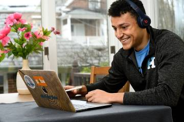 Hopkins student watching videos on laptop
