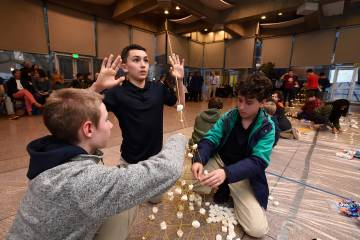 Participants build structures from marshmallows and pasta at Tower of Power
