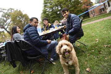 A family brings their dog to Family Weekend