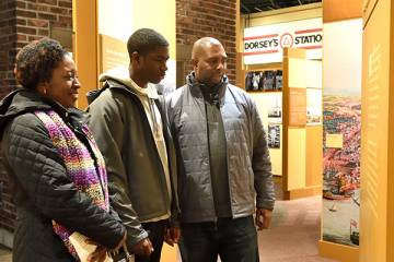 A family views an exhibit at the Reginald F Lewis Museum