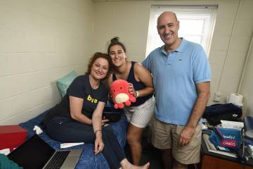 Andrea Guillen and her parents in her room in AMR II
