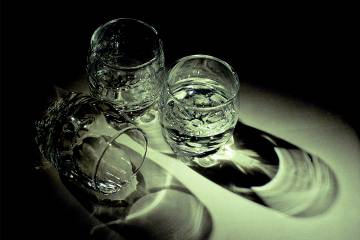 Three shot glasses on a table