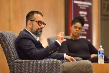 Suroosh Alvi on stage with Shawna Thomas, D.C. bureau chief for VICE