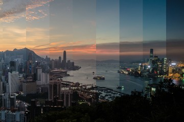 Time-lapse panoramic photo of Hong Kong harbor is sliced into narrow vertical panels each depicting a different time of day, reassembled into one collage-like image