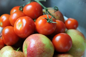 Pile of red apples and tomatoes