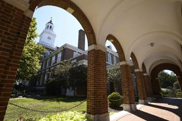 Gilman Hall tower, as seen from beneath the arches of an adjacent walkway