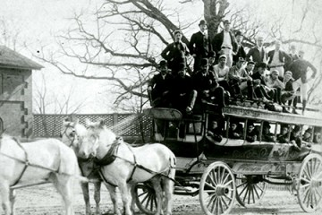 A horse-drawn carriage bus