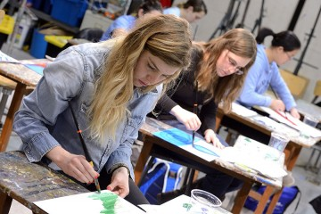 Students paint during art therapy course