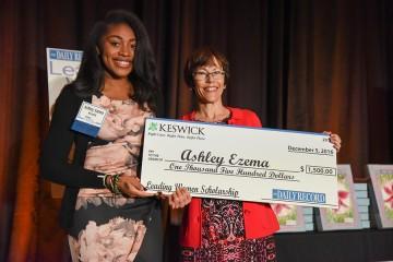 Ashley Ezema receives $1500 novelty check as scholarship recipient