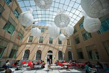 Large white paper lanterns hang over atrium space