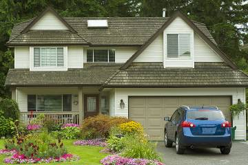 Pretty suburban house with car in driveway