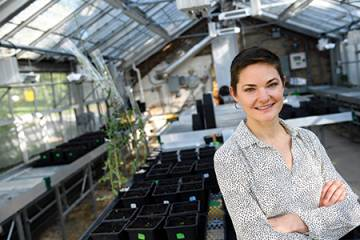 Postdoc Ava Hoffman in the Homewood greenhouse