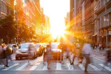 Sun rises over city street