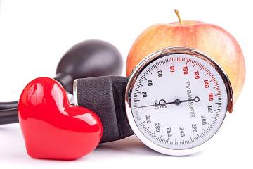 Blood pressure gauge, apple, and shiny red heart