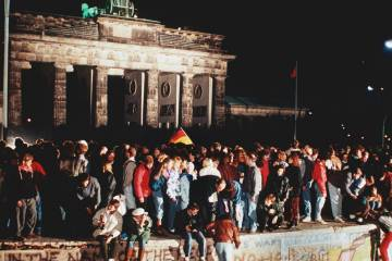 East Berliners scale the Berlin Wall at night