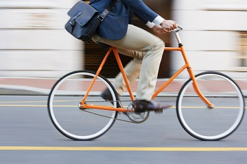 Man in business clothes riding a bike