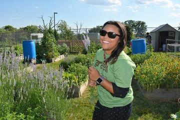 A volunteer holds a stalk of lavender