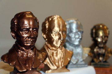 A closeup photo of a small bronze bust