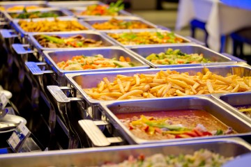 A buffet of foods ranging from vegetables to french fries