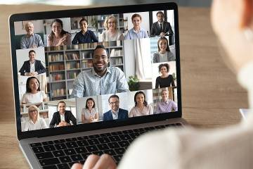 Laptop showing group of engaged employees in a Zoom meeting