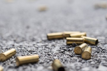 Bullet casings lie on a street
