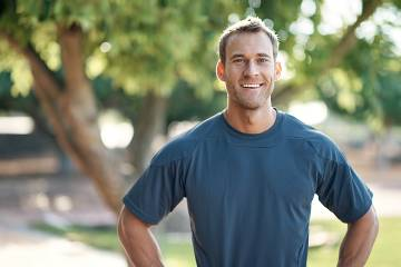 Healthy-looking smiling man photographed outdoors