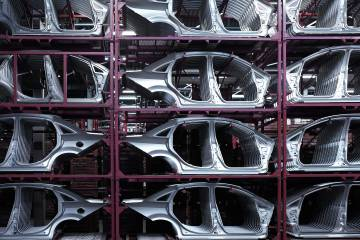 Steel car frames in an automotive manufacturing plant