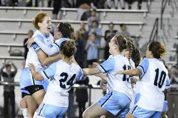 Hopkins women's soccer players celebrate