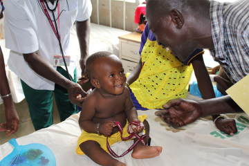 A child with health workers
