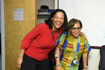 Deidra Crews (left) celebrates with Lisa Cooper after being surprised with President's Frontier Award