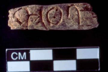 Alphabetic text inscribed on a beadlike form