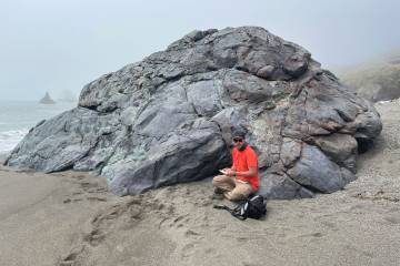 Daniel Viete next to a rock formation in California