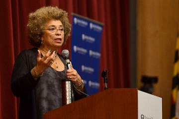 Angela Davis at podium with microphone