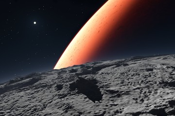 Red planet seen from rocky surface of moon