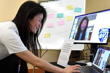 Exhibitor Nikki Tang demonstrates how she uses augmented reality to teach facial anatomy
