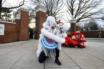 Two Chinese dragons, one white and one red, by the East Gate of Johns Hopkins University's Homewood campus