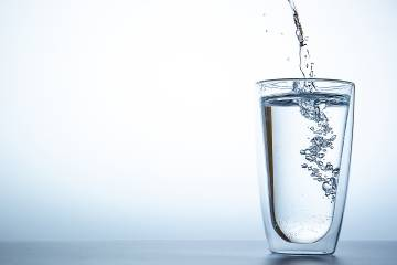Water being poured into a large tumbler