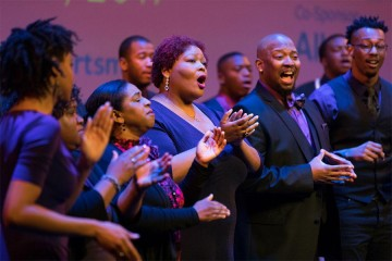 Choir singers perform